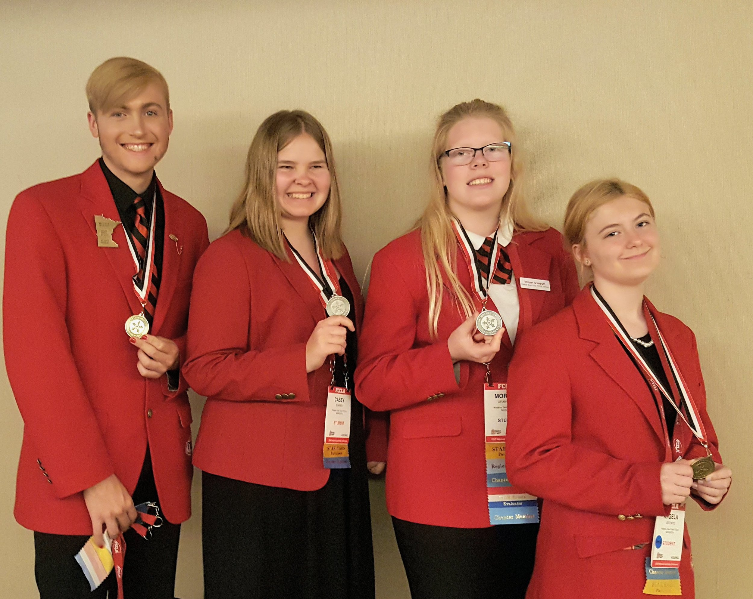 From left: Wadena-Deer Creek FCCLA members Elliot Doyle, Casey Bounds, Morgan Grangruth and Angela LeComte display their STAR events medals they earned at the national conference in Anaheim, Calif. Photo by Cindi Koll, FCCLA co-advisor.