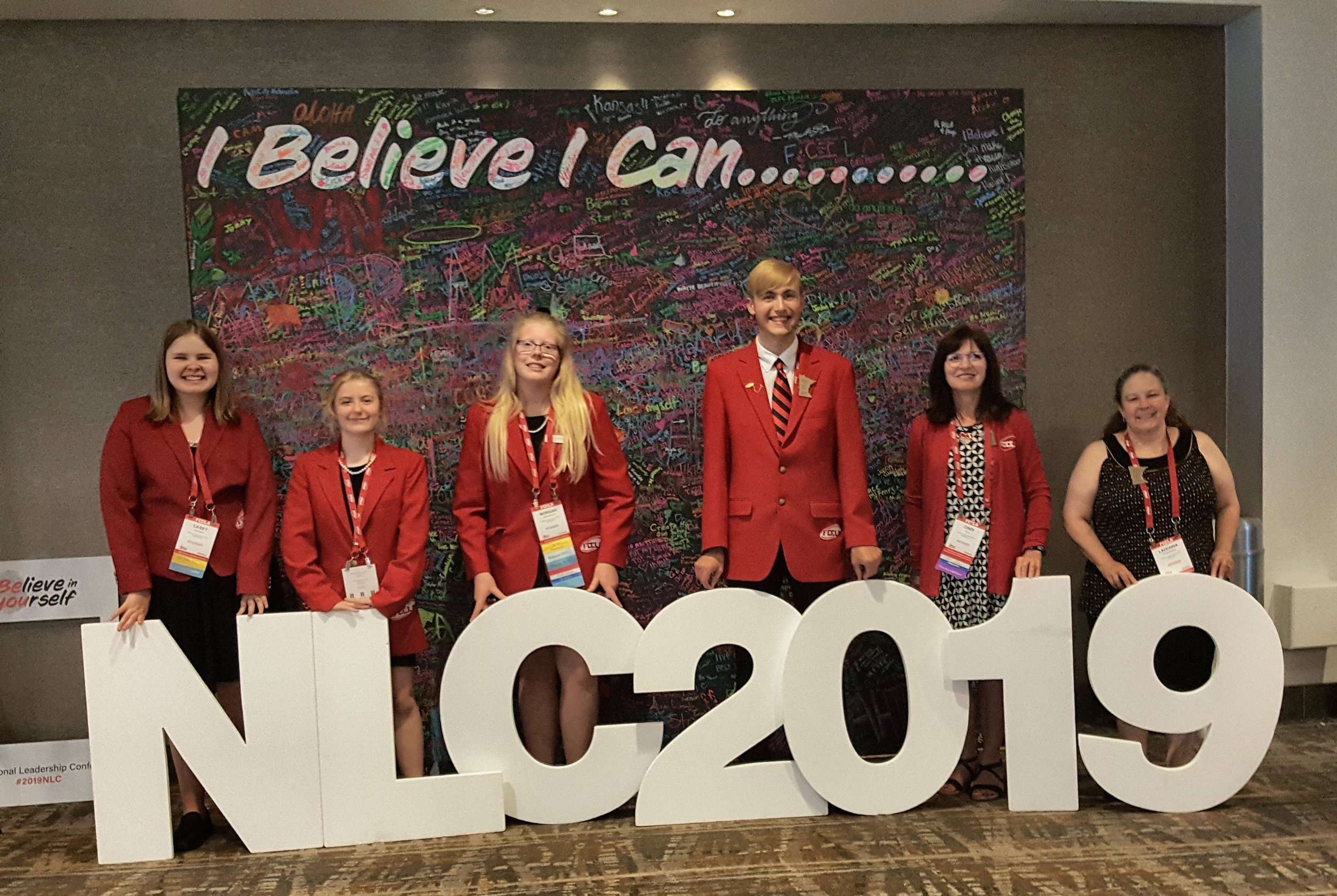 The FCCLA National Leadership Conference 2019 theme is displayed in the background and attending from Wadena-Deer Creek High School, from left: WDC FCCLA members Casey Bounds, Angela LeComte, Morgan Grangruth, and Elliot Doyle, and co-advisors Cindi Koll and LaDonna Norenberg. Courtesy photo.