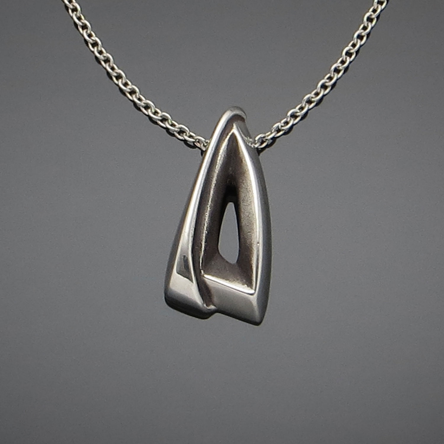 #111 Hooded Triangle pendant