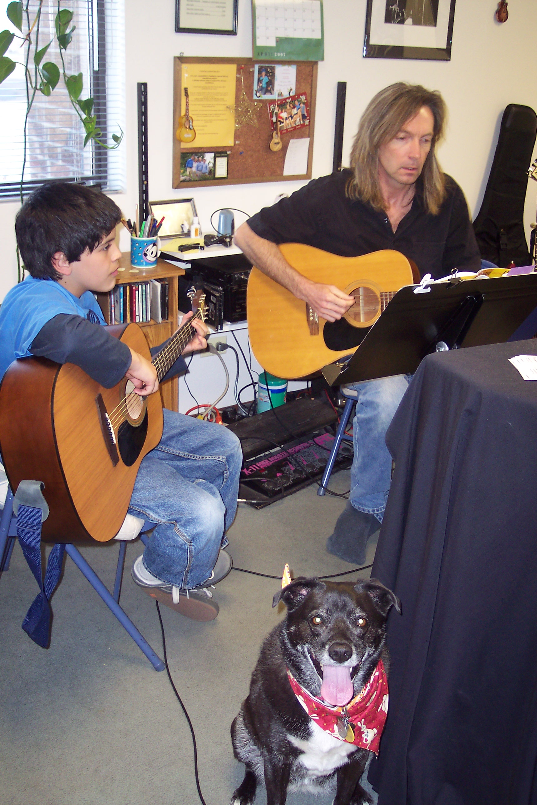 Bill with guitar student and a canine buddy