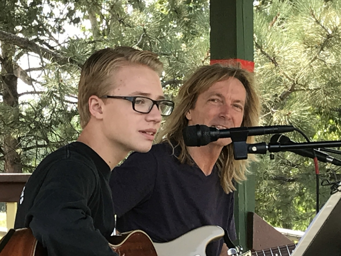 guitar tutor performing with student