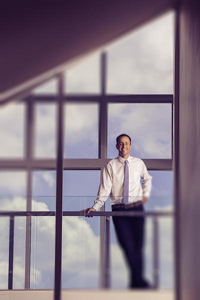 UNCC Belk College of Business professor poses for a portrait.