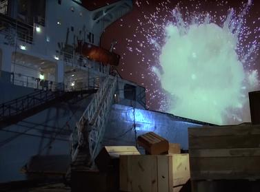 Why is the explosion behind the ship?