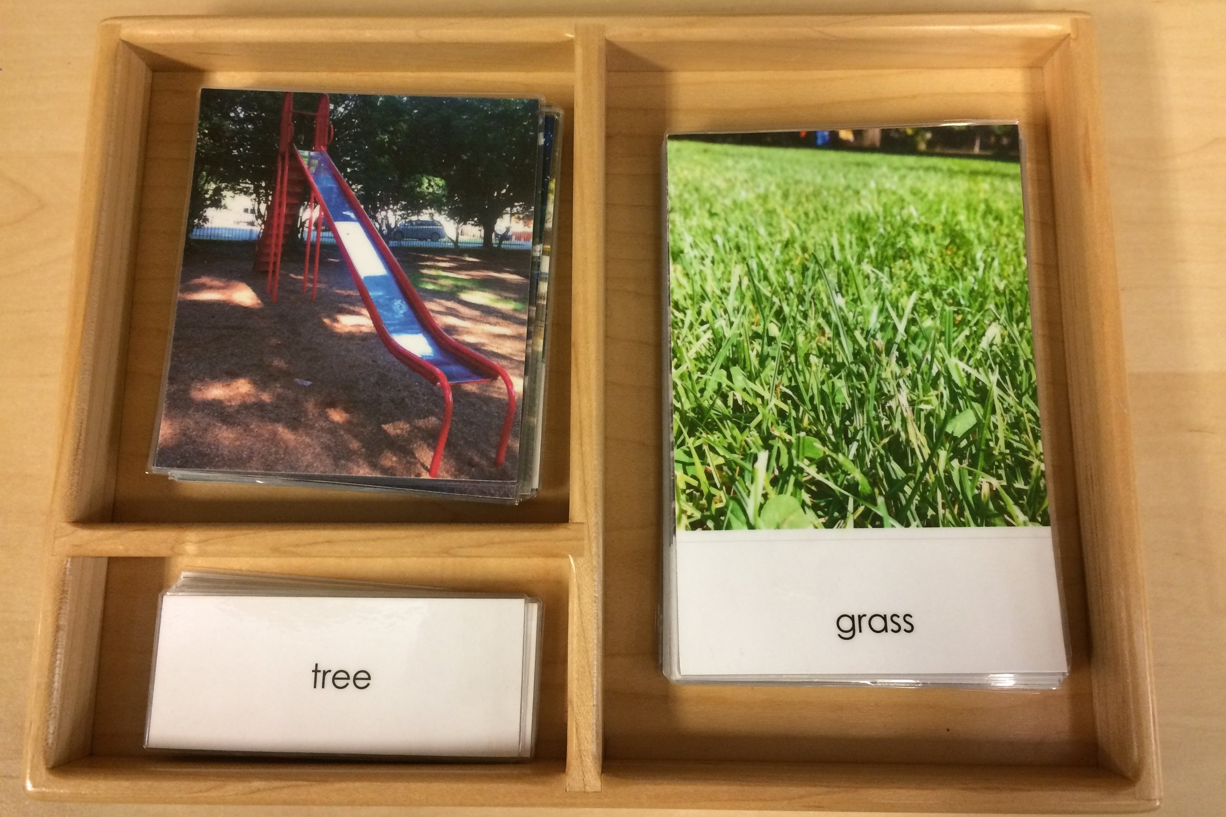 A simple set of cards can be made by photographing familiar places. Here's the park down the street from my daughter's Children's House!