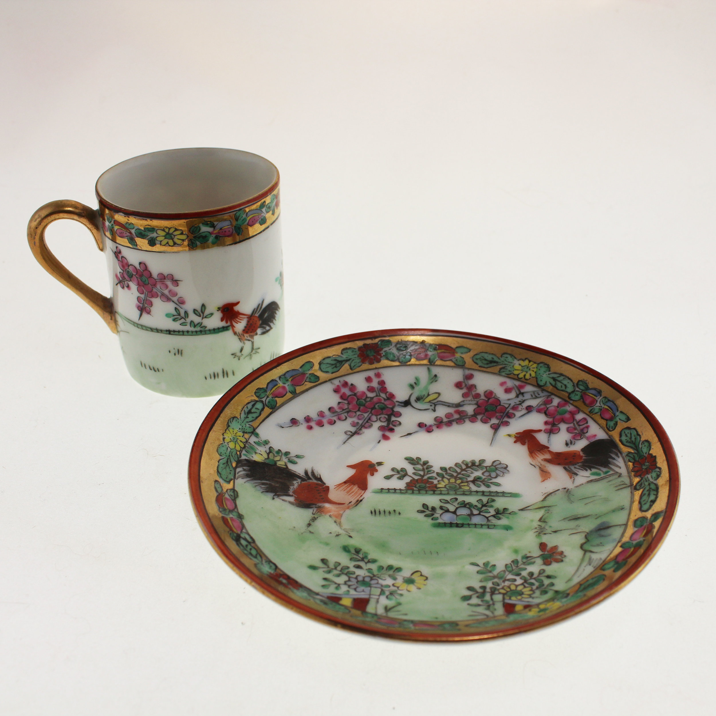 Gilded antique handpainted rooster teacup and saucer