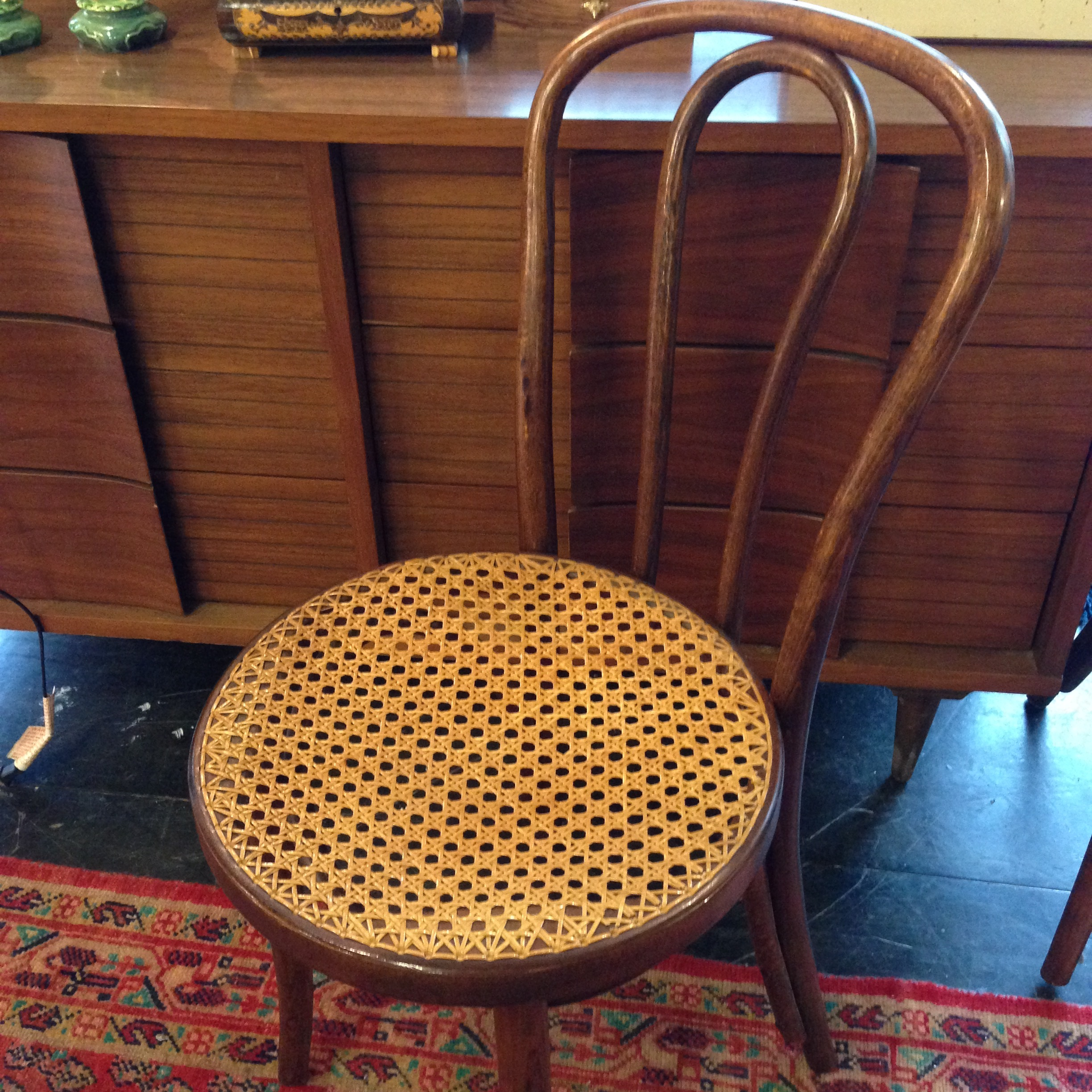 bent back caned chair
