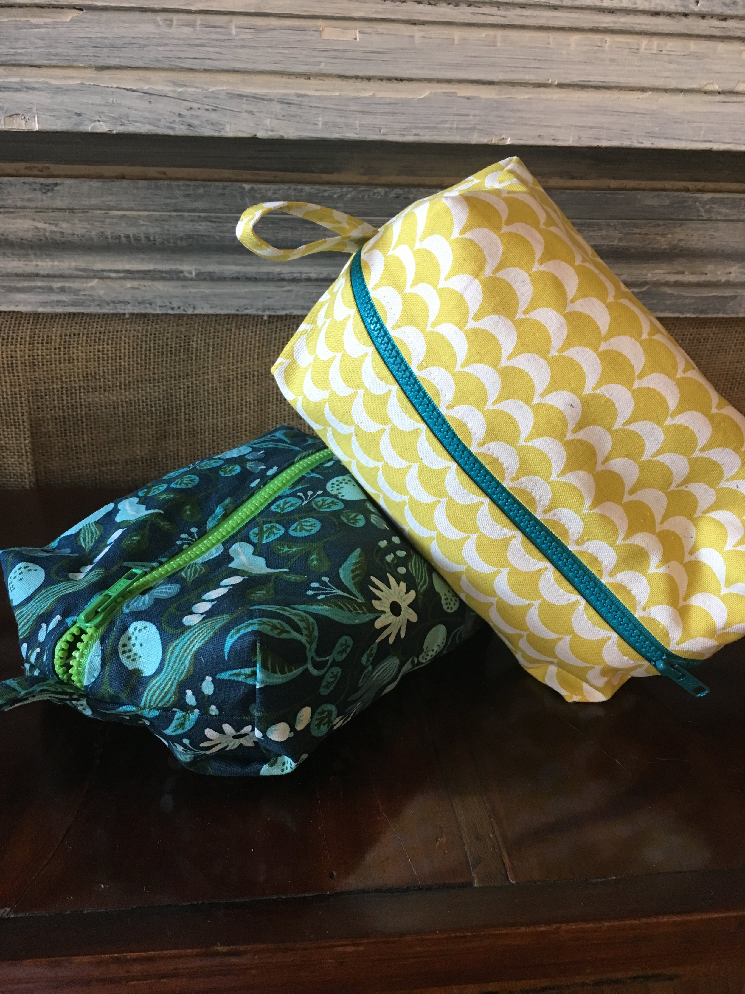 Just the Basics - Zippered Dopp Kit - Advanced Beginner Sewing Class -This is a 3 hour class where we will construct a fully lined zippered tote. Perfect for travel, sewing supplies and even your lunch. You will learn a simple way to put in a zipper, create gussets and how to put in a lining.Basic machine skills required.Please bring your machine in good working order (or you can rent one from us), sewing tools and fabric of your choice.You will need two complimentary fabrics. Zippers will be supplied. If you choose to purchase fabric at EBM you will get student discount of 20%.Skill Level: advance beginner/intermediateWhen: Wed. August 21 from 6-9 pmCost: $45.00 for the class, Machine rental an additional $10