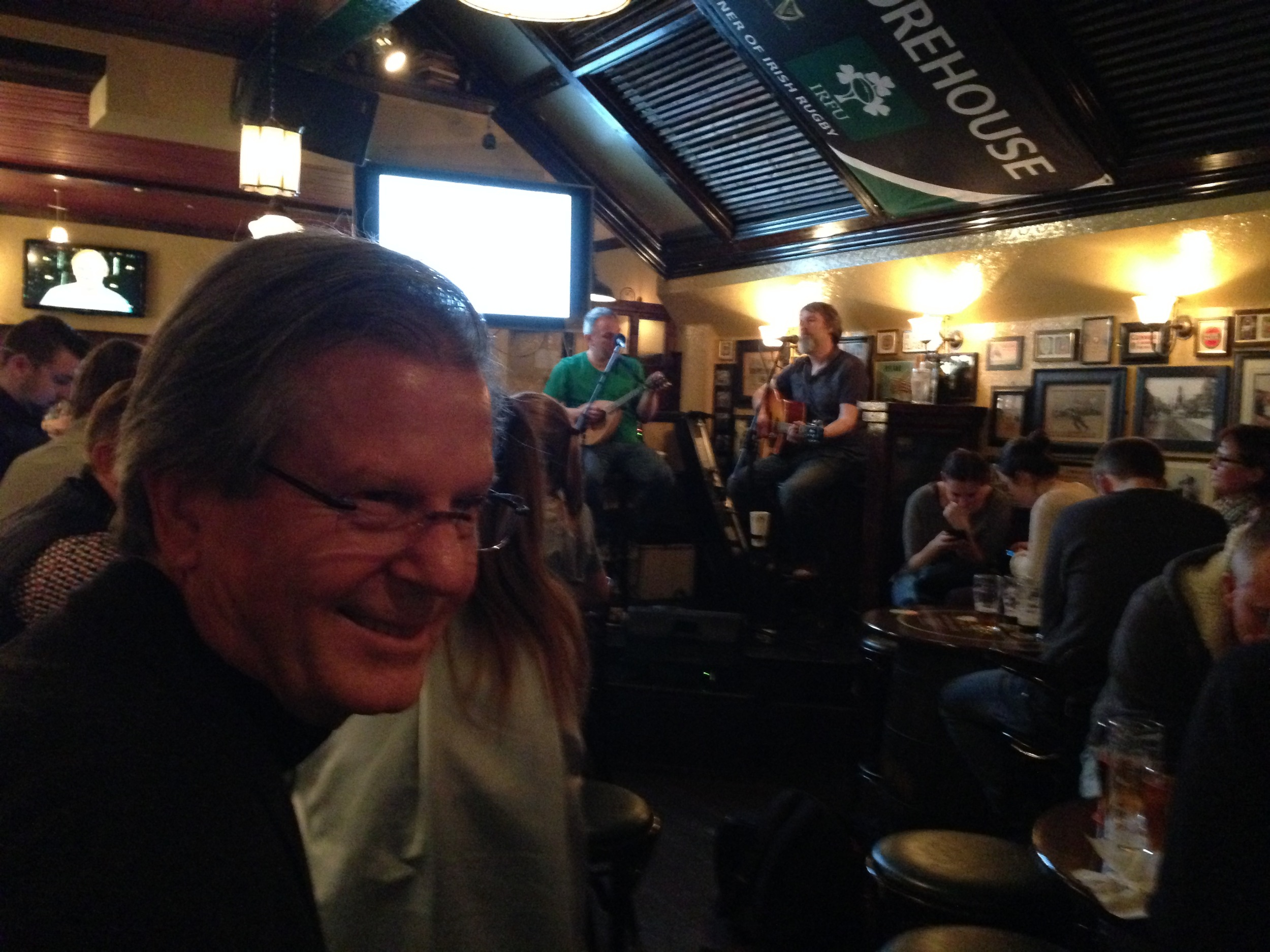 At a pub listening to traditional Irish music.