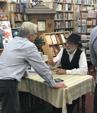 Rabbi Arthur Gross Schaefer signs a book for a fan.