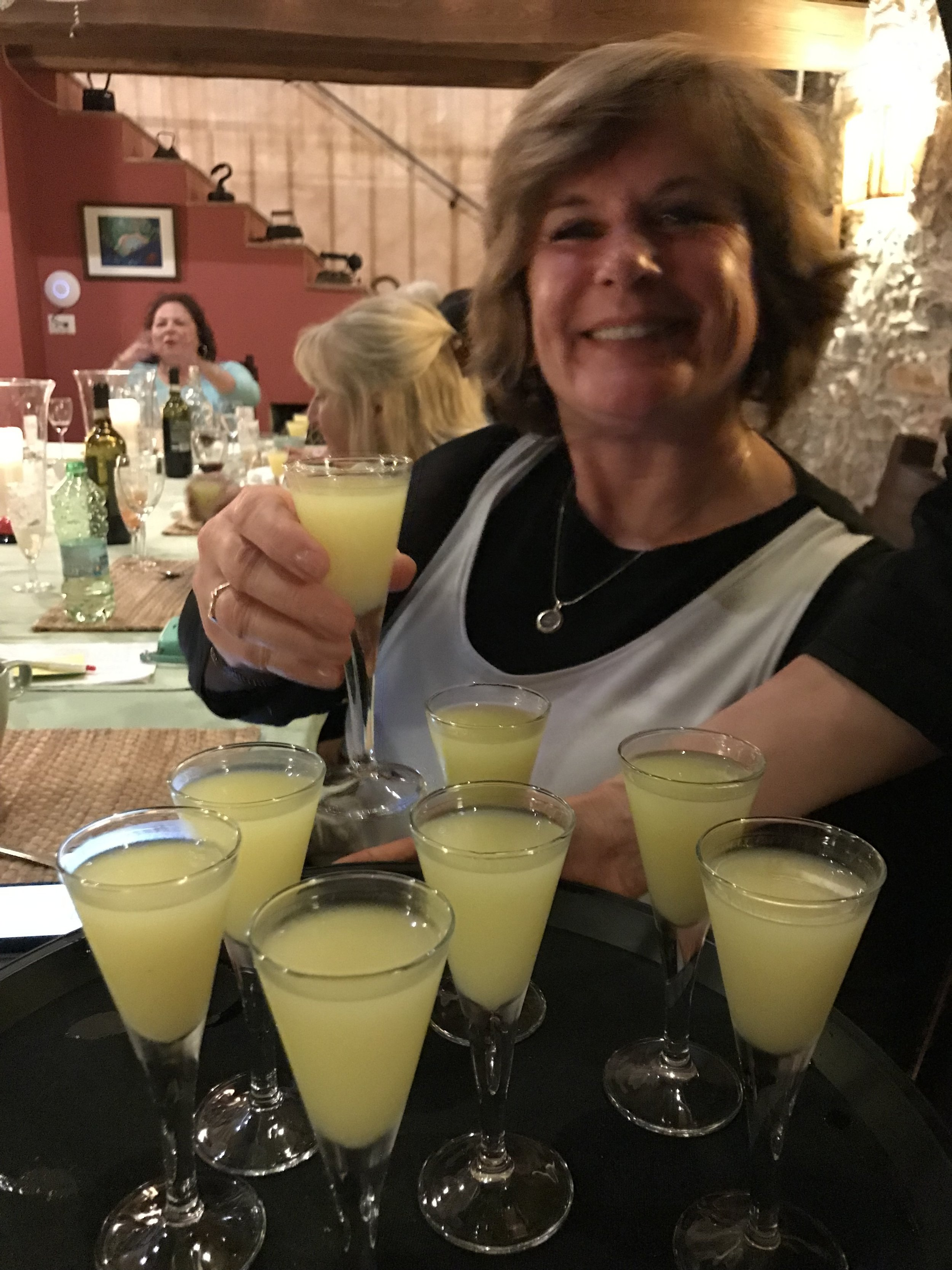 Kathleen with the limoncello we made.