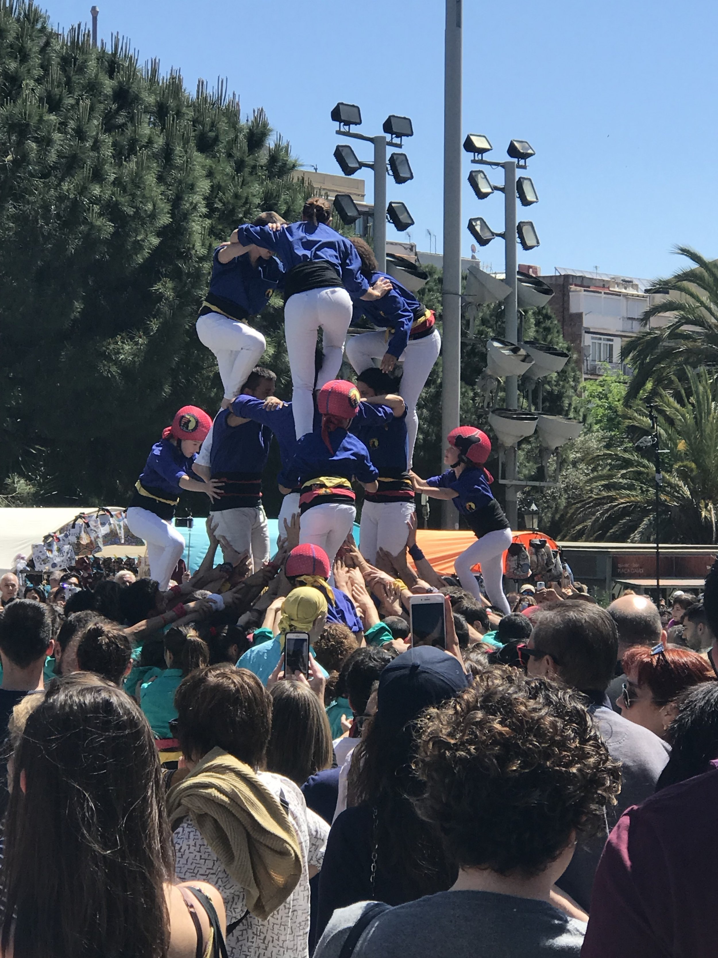 Castelleers climb on top of each other to build a human tower
