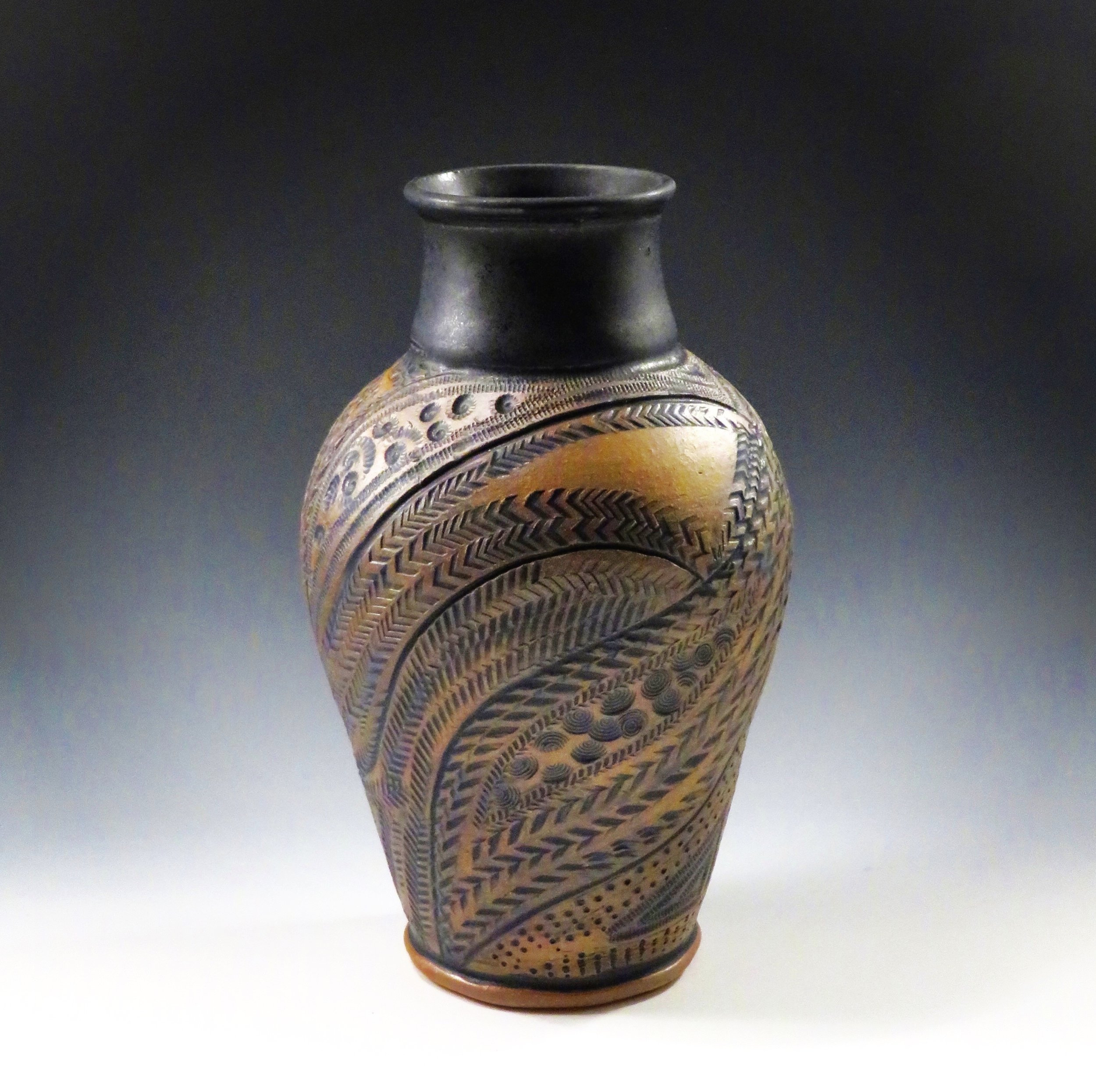 Brown/ black vase, carved and stamped