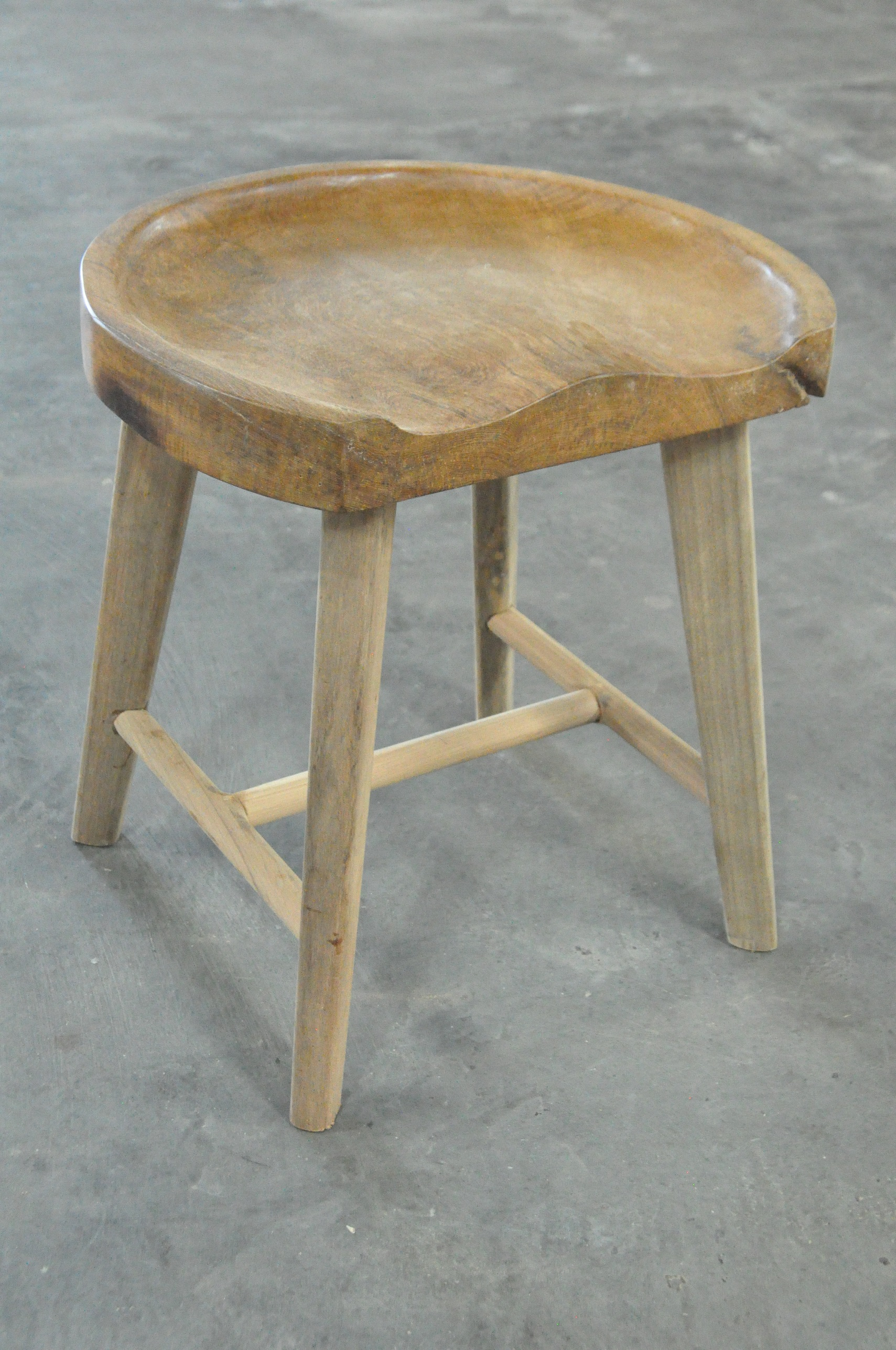 "Curved Stool  17""Wx14""Dx18""H  Price: $215"