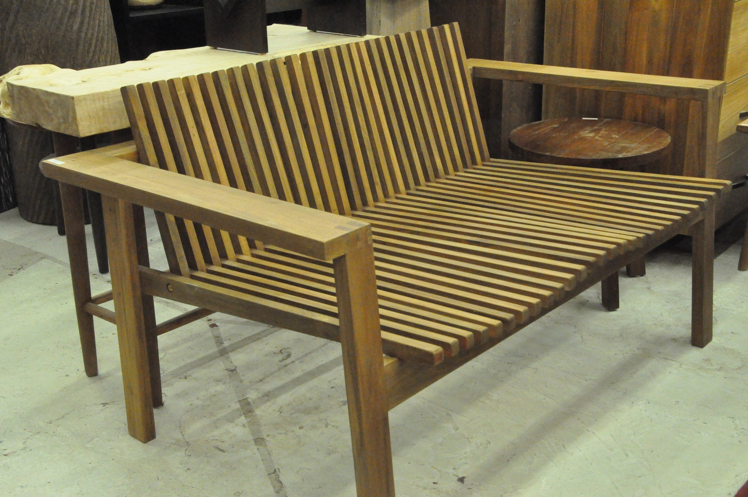 "Ombak Slatted Bench  55""Wx33""Dx31""H. Price: $665"
