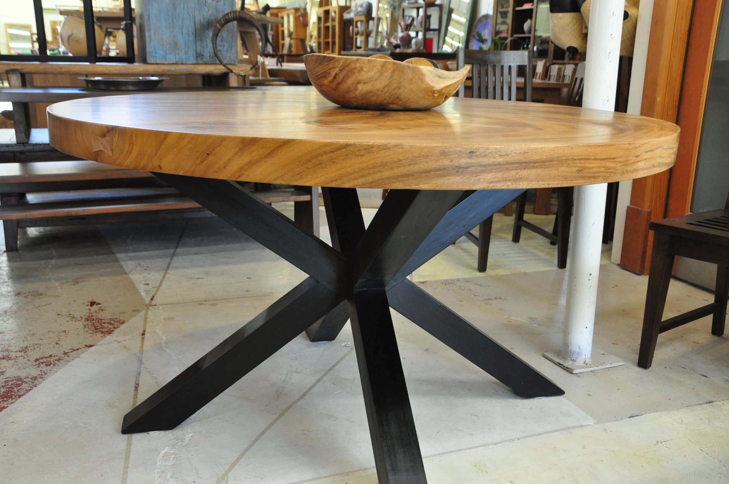 "Rose Wood Splayed Round Table  Price: $2,250  55""D x 30""H"