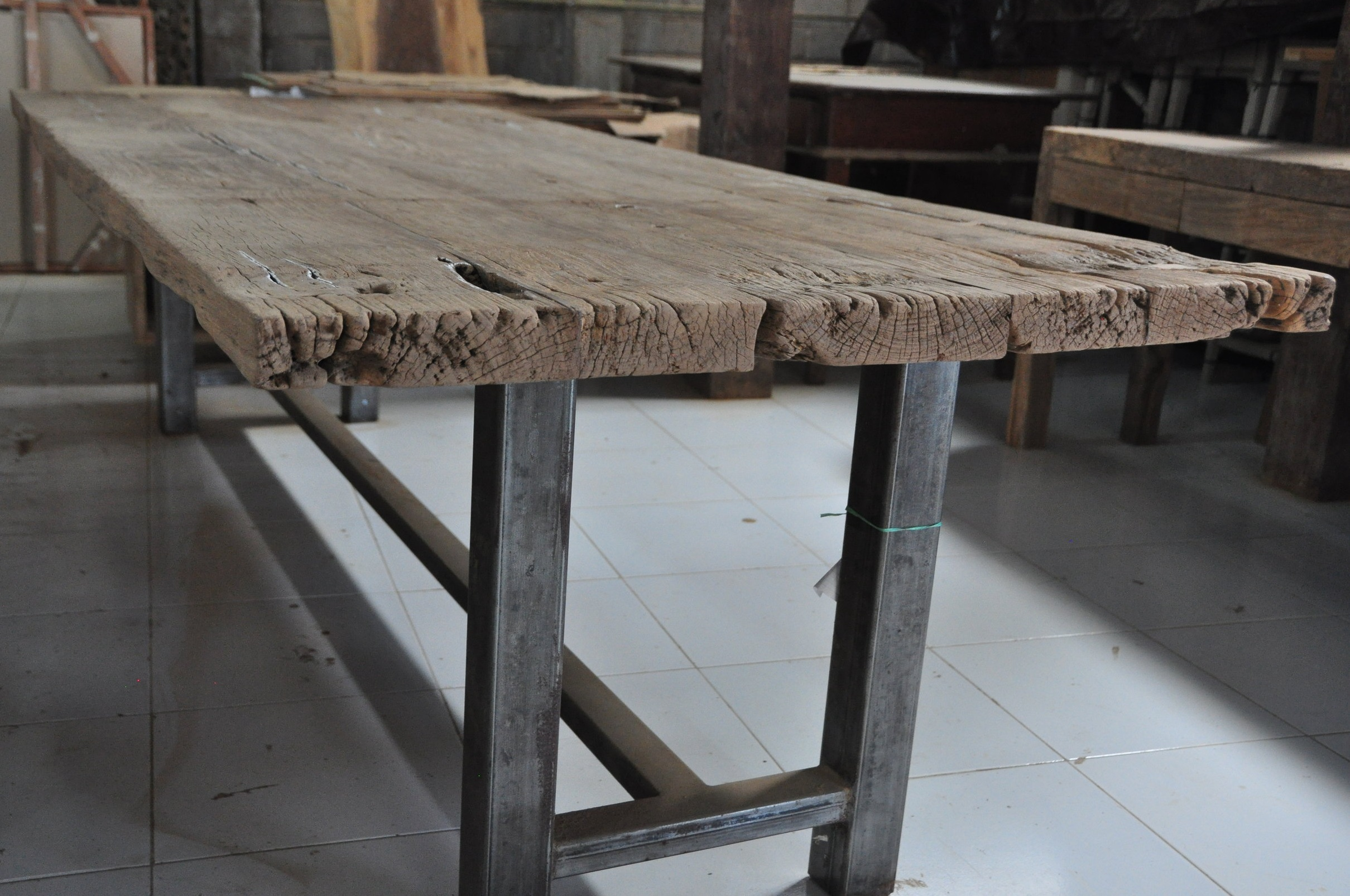 "Besi Table  $1,660, 73""L x 31""D x 30""H  $2,678, 106""L x 39""D x 30""H  $3,000, 126""Wx40""Dx30""H"