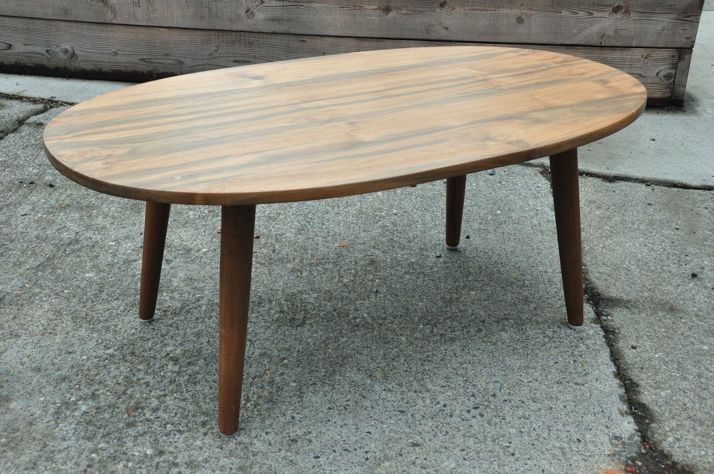 "Oval Teak Coffee Table  42""W x 24""D x 14""H  Price: $498"