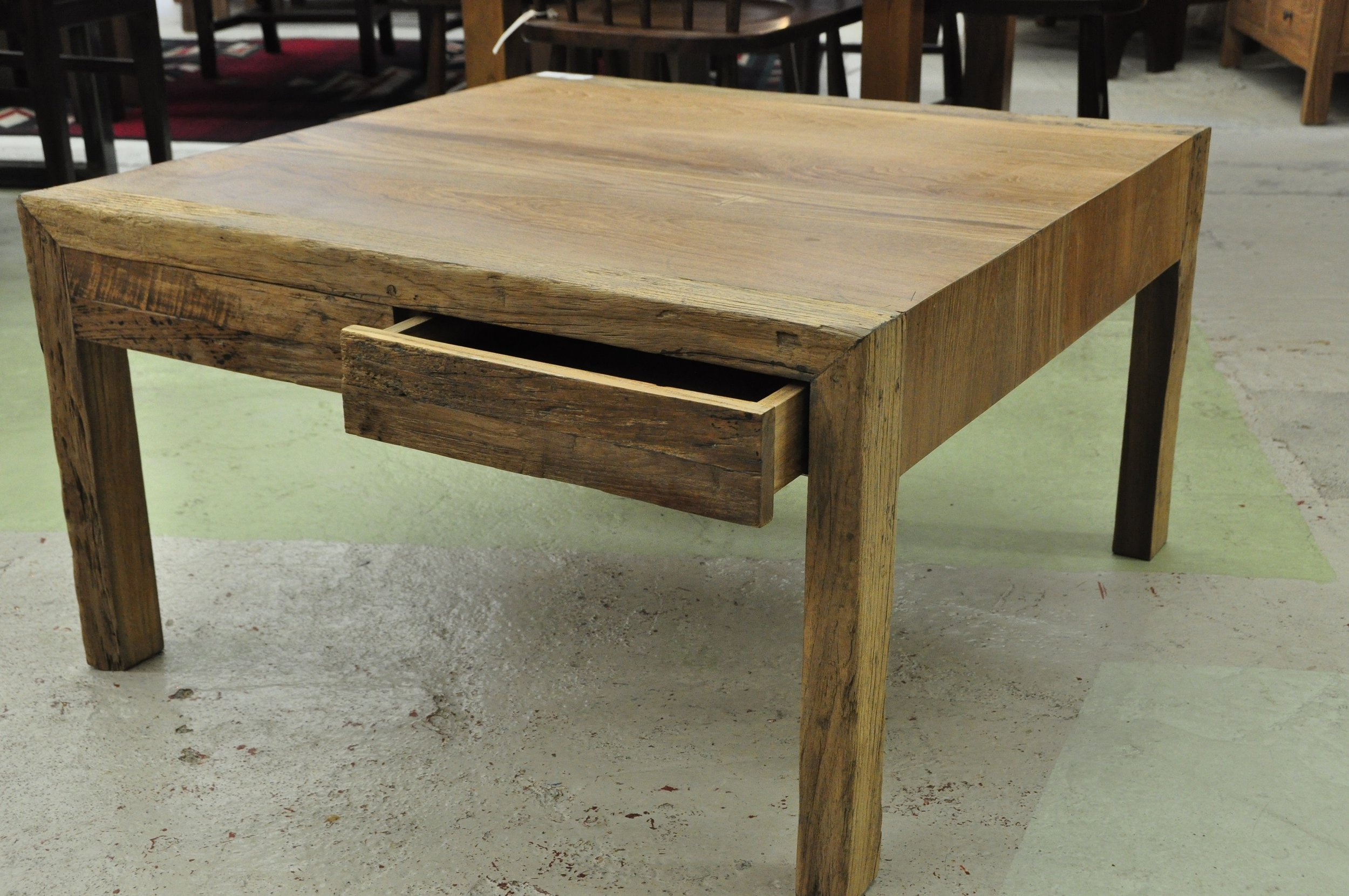 "Aus Square 4-Drawer Coffee Table  31""W x 31""D x 18""H  Price: $700"
