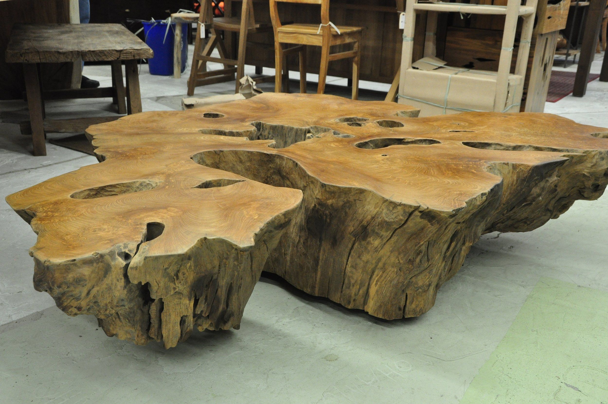 "Root Coffee Table on Wheels  59""W x 51""D x 13""H Price: $2,129  67""W x 28""D x 18""H Price: $1,800"
