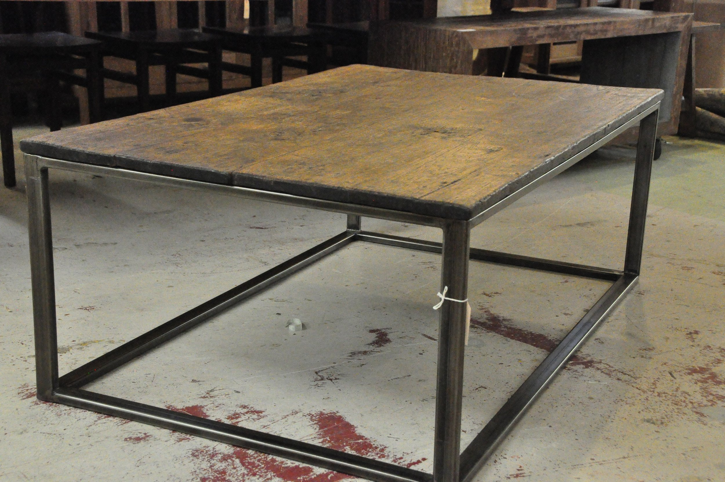 "Menara Teak Coffee Table Metal Base  53""W x 34""D x 19.75""H  Price: $855"