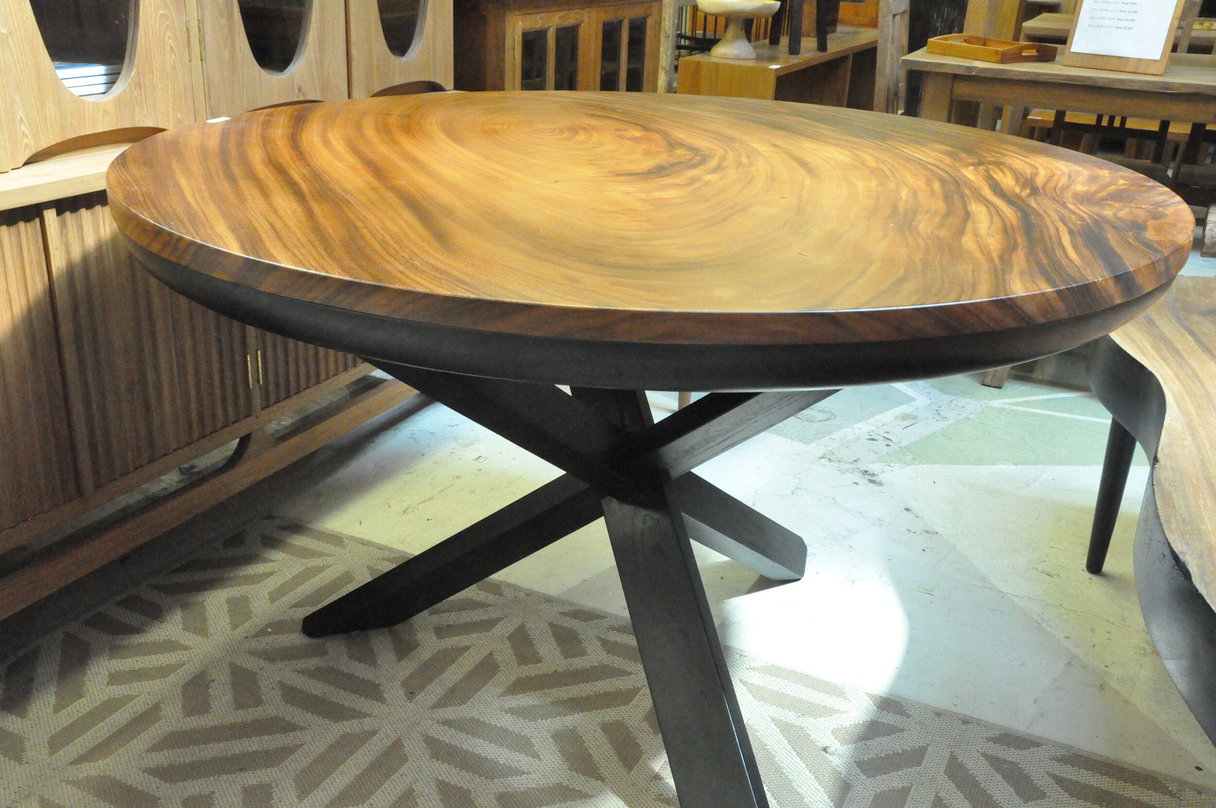 "Saman Round Criss Cross Table  51""Dx30""H  Price: $1,965"