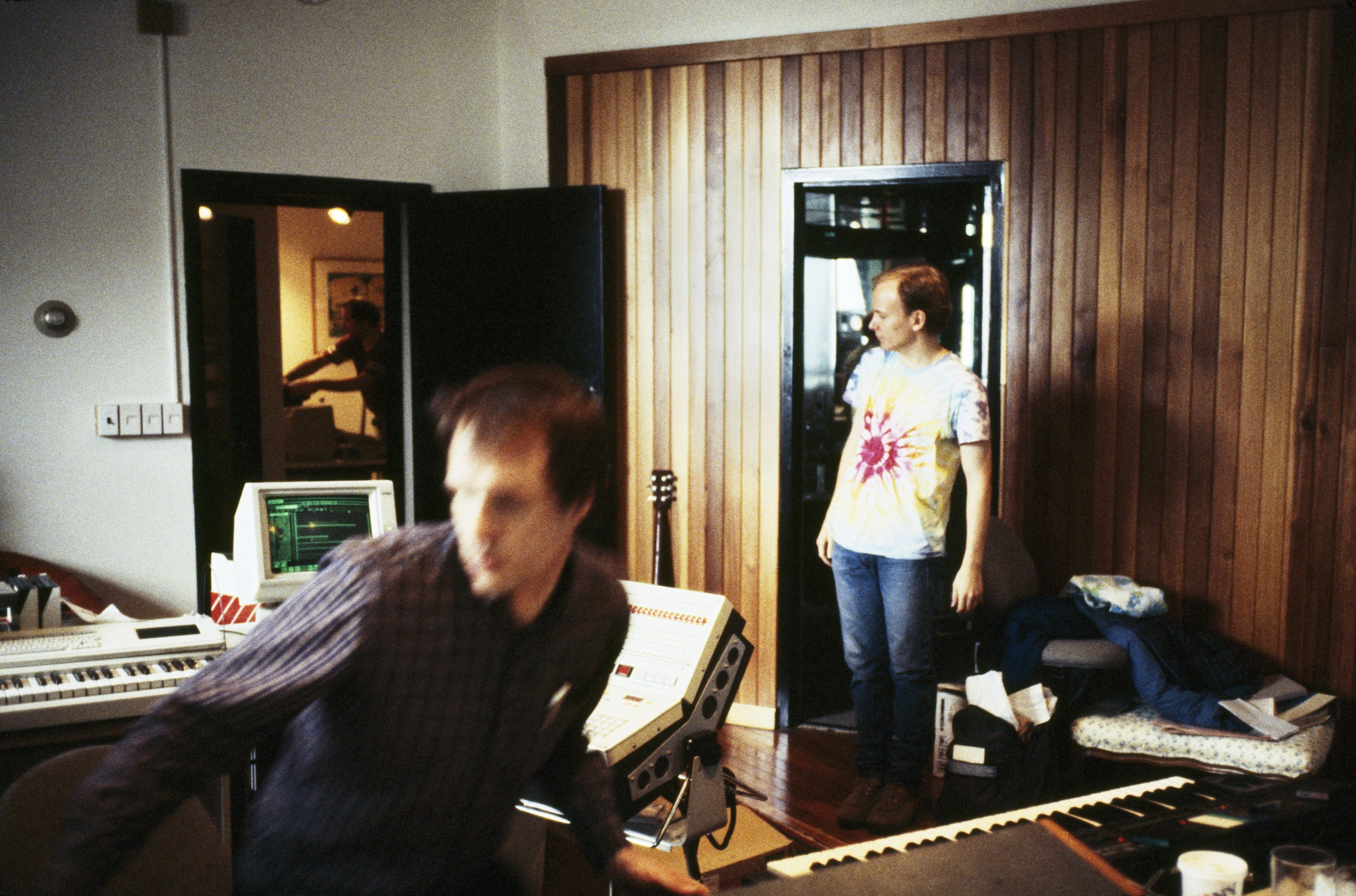 Arthur Russell recording music at Battery Sound in the early 1980's. Eric Muiderman, student of Peter Zummo and an apprentice of Arthur, stands on the right. Mark Freedman works in the adjoining room. Photograph by and courtesy of Peter Zummo.