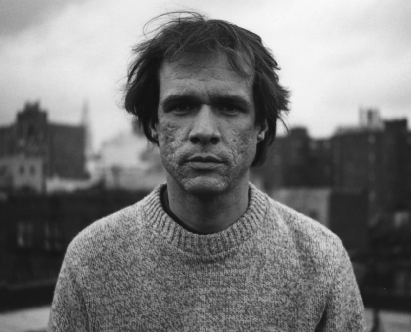 Arthur Russell on the rooftop of his home at 437 East Twelfth Street, mid-1980s. Photograph by Tom Lee.