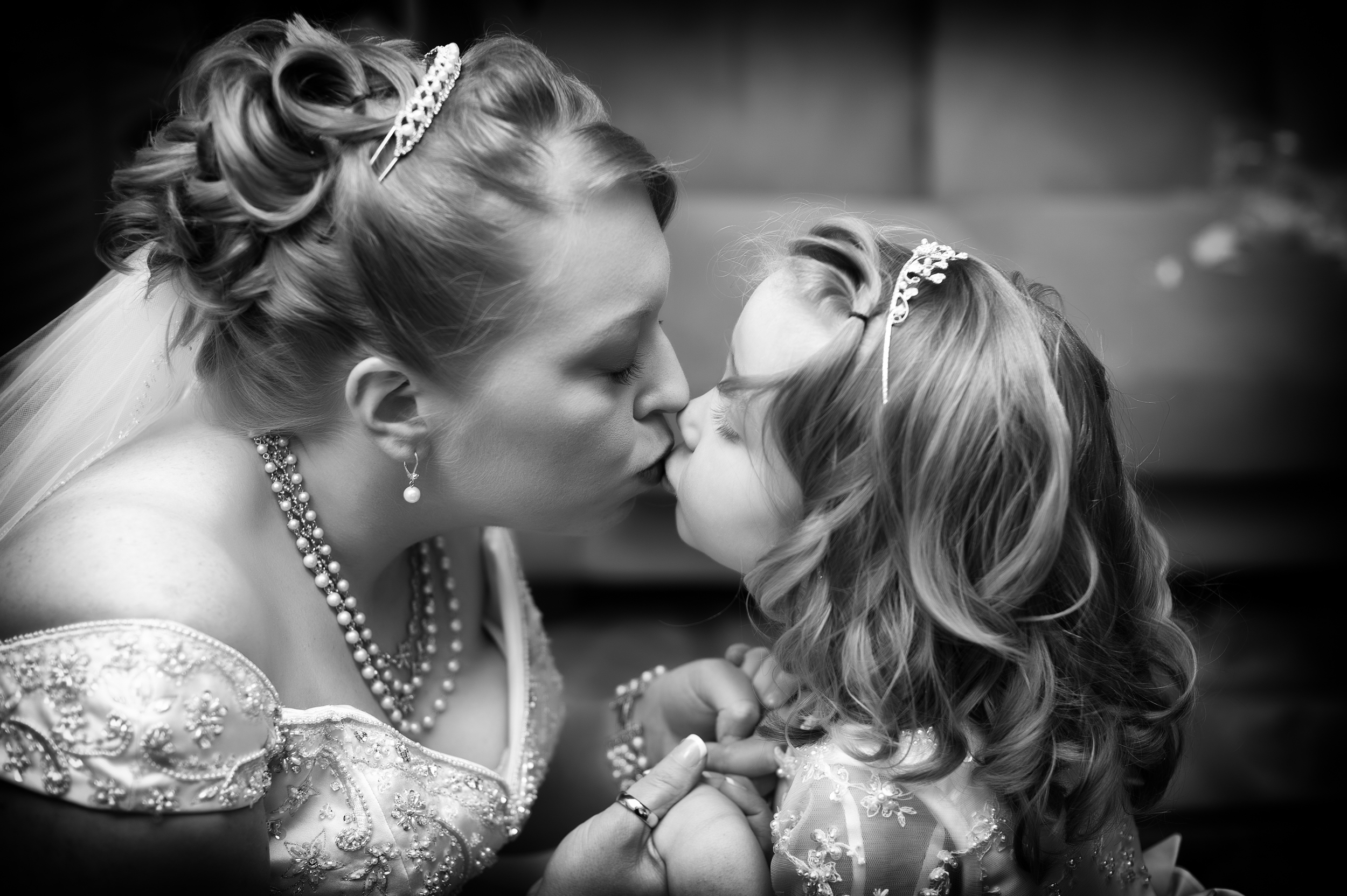 A Bride Kisses her Daughter the Flowergirl on her wedding day, Kenneth Light Studios