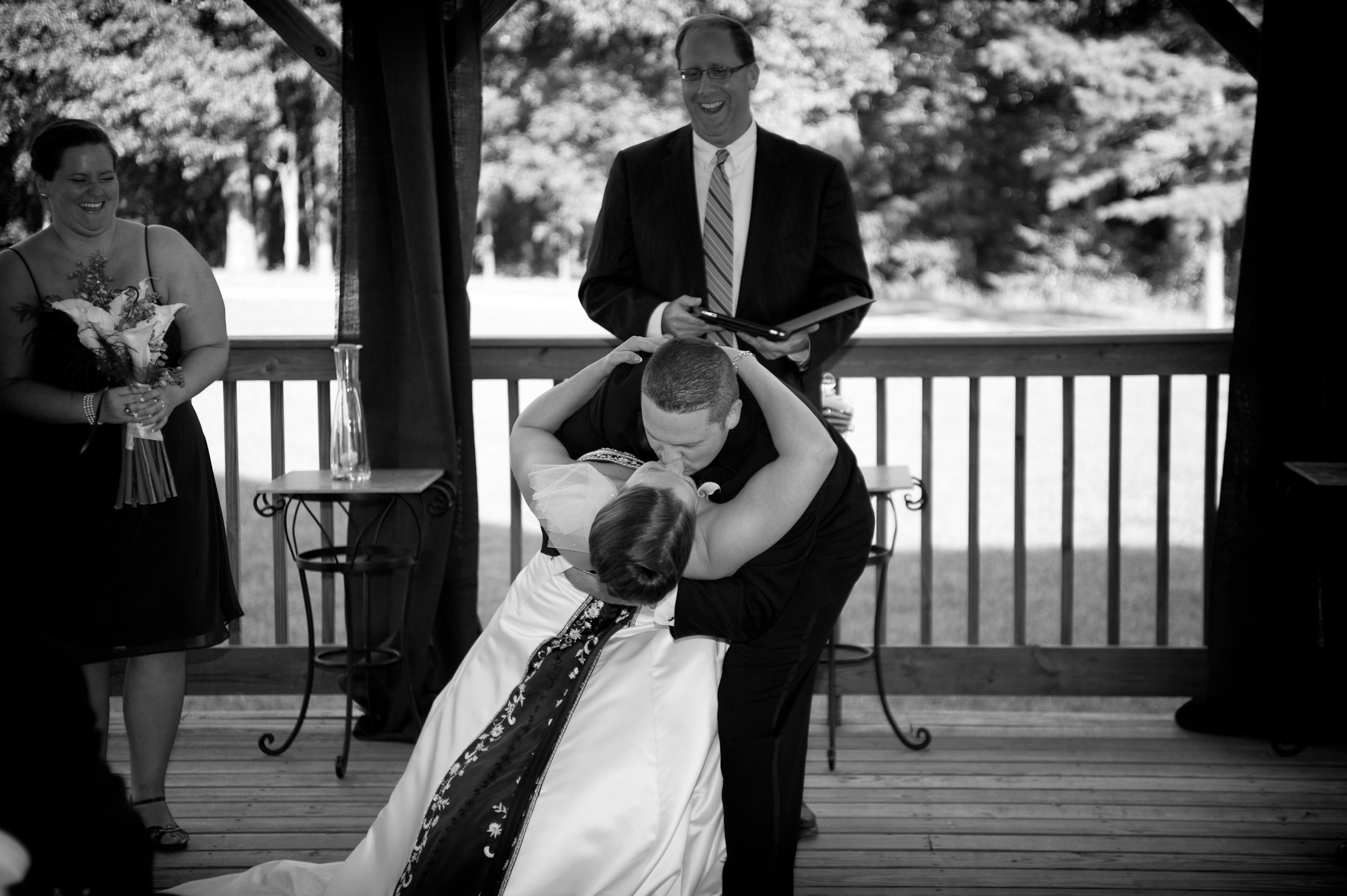 Bride and Groom Kiss at Winery