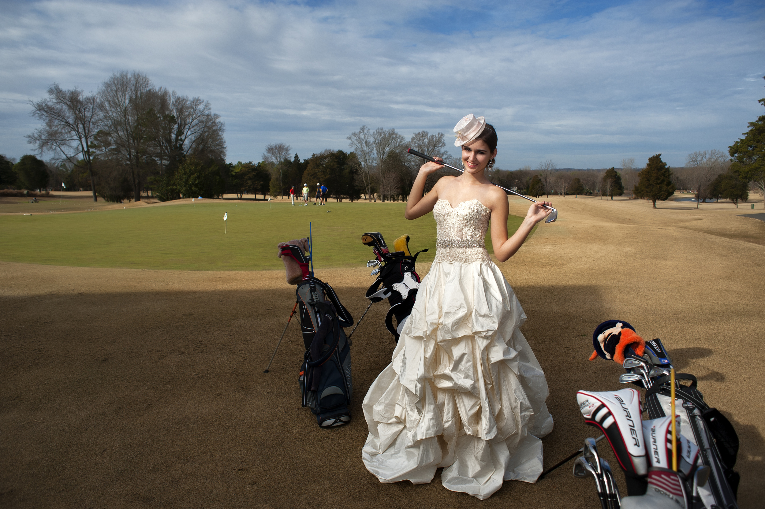 Bride on a Golf Course by Basingstoke Wedding Photographers, Kenneth Light Studios