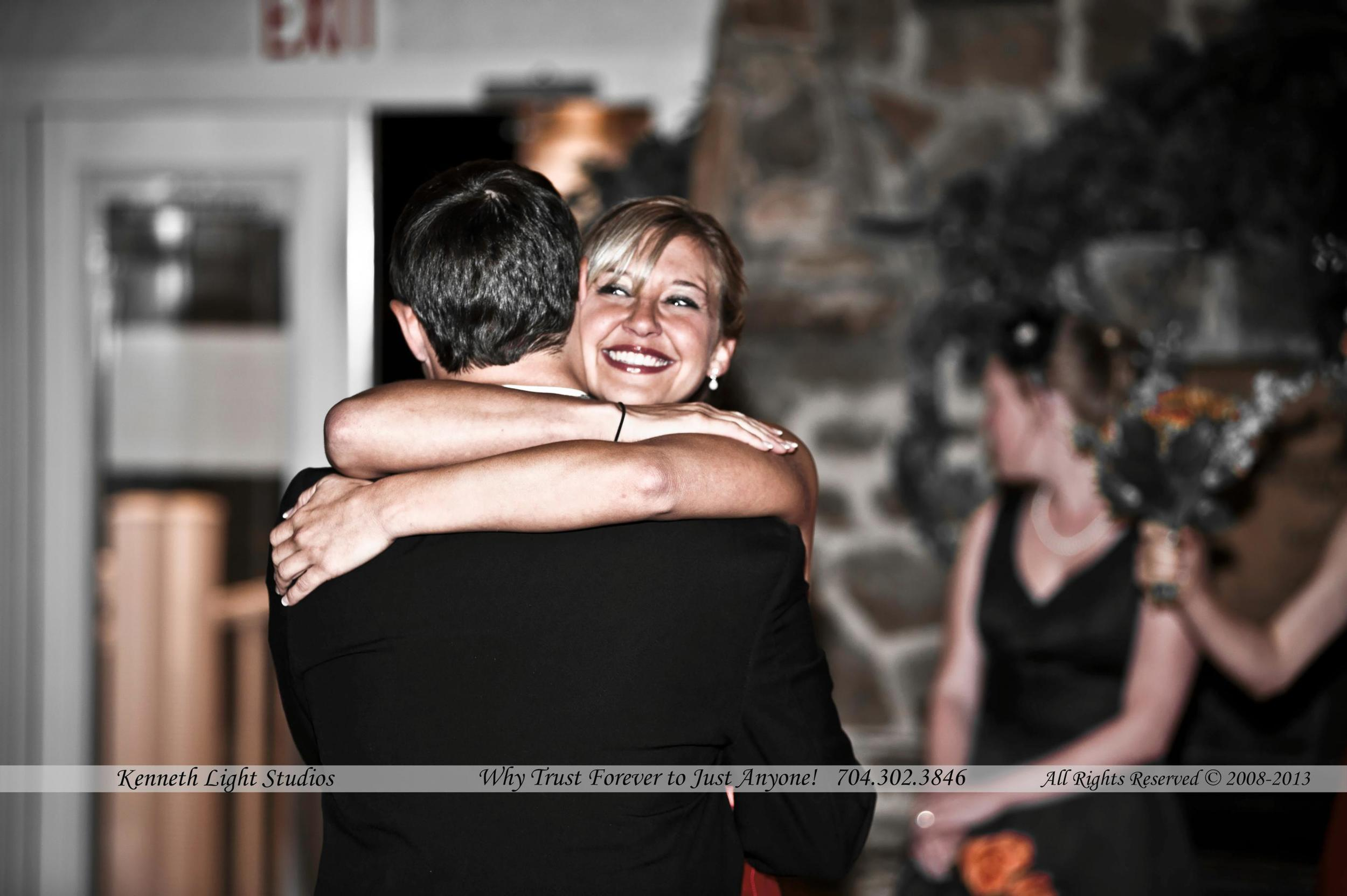 Charlotte Wedding Photographers, Kenneth Light Studios, A sister hugs her brother at his wedding