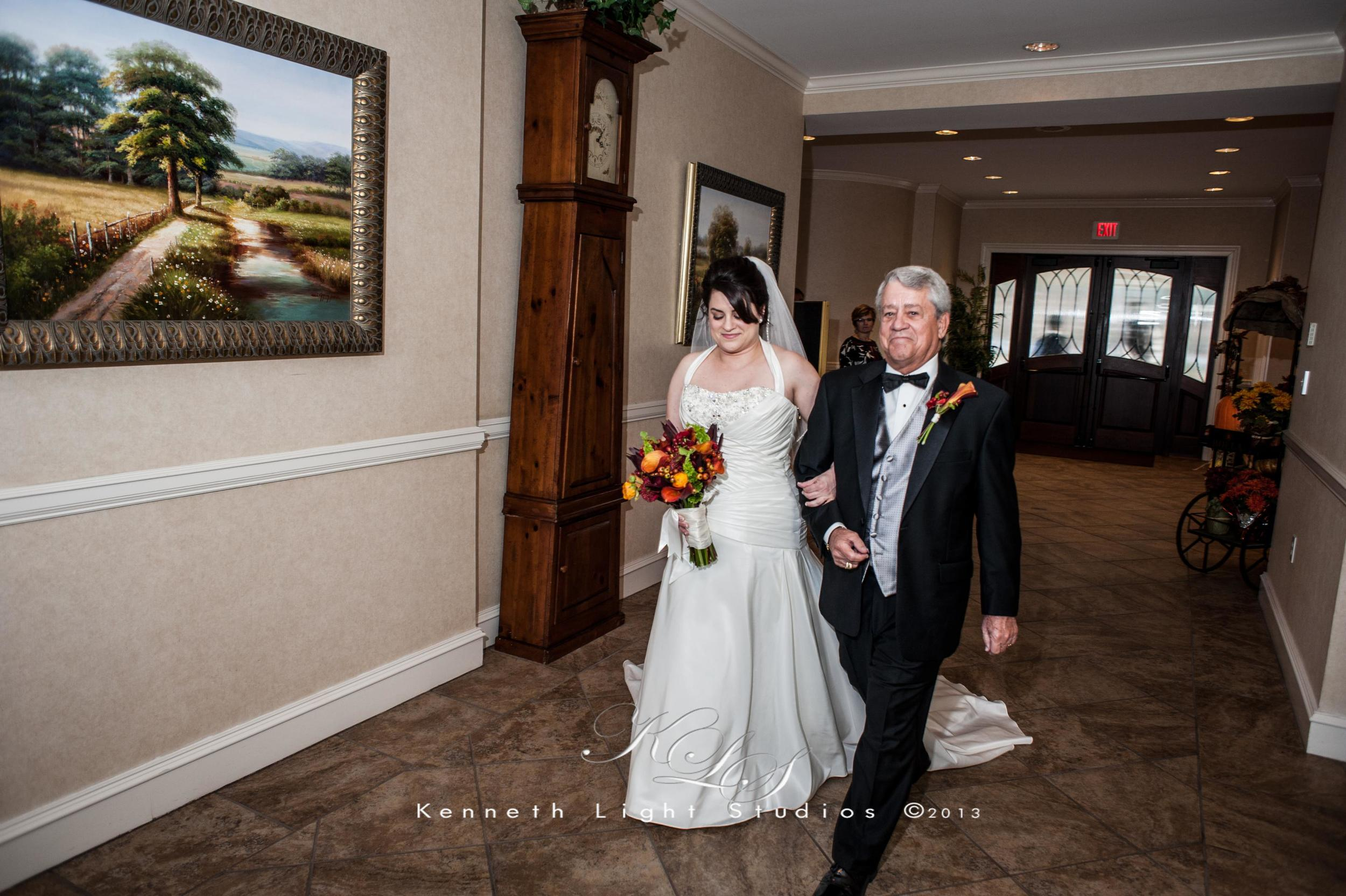 Father and bride walk