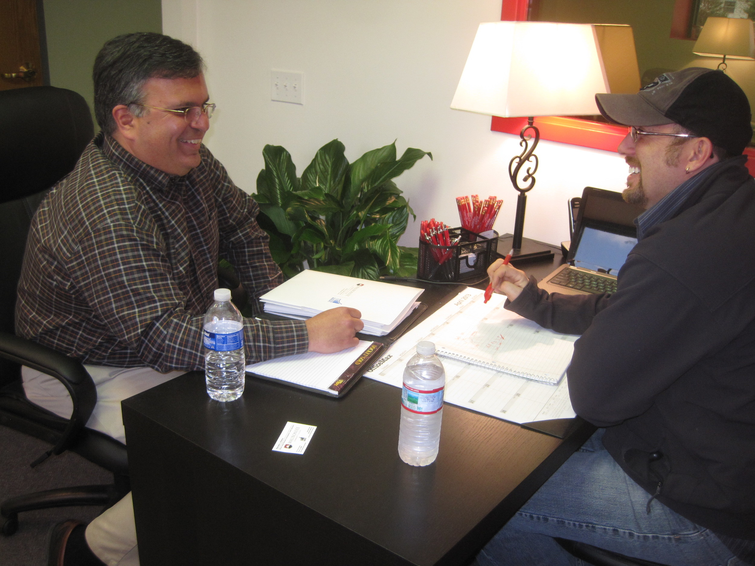 Crown Exteriors President Chad Poegel talking shop with Small Business Administration representative Marcelo Alvarez.