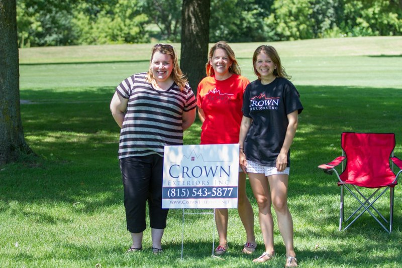 """Crown Exteriors staff helped golfers cool off at the Genoa Chamber's Olympics-themed golf tournament by hosting a game of """"flippy cup"""" on the 16th hole. Winners took home limited edition Crown pub glasses.   image courtesy of JK Richards Photography"""