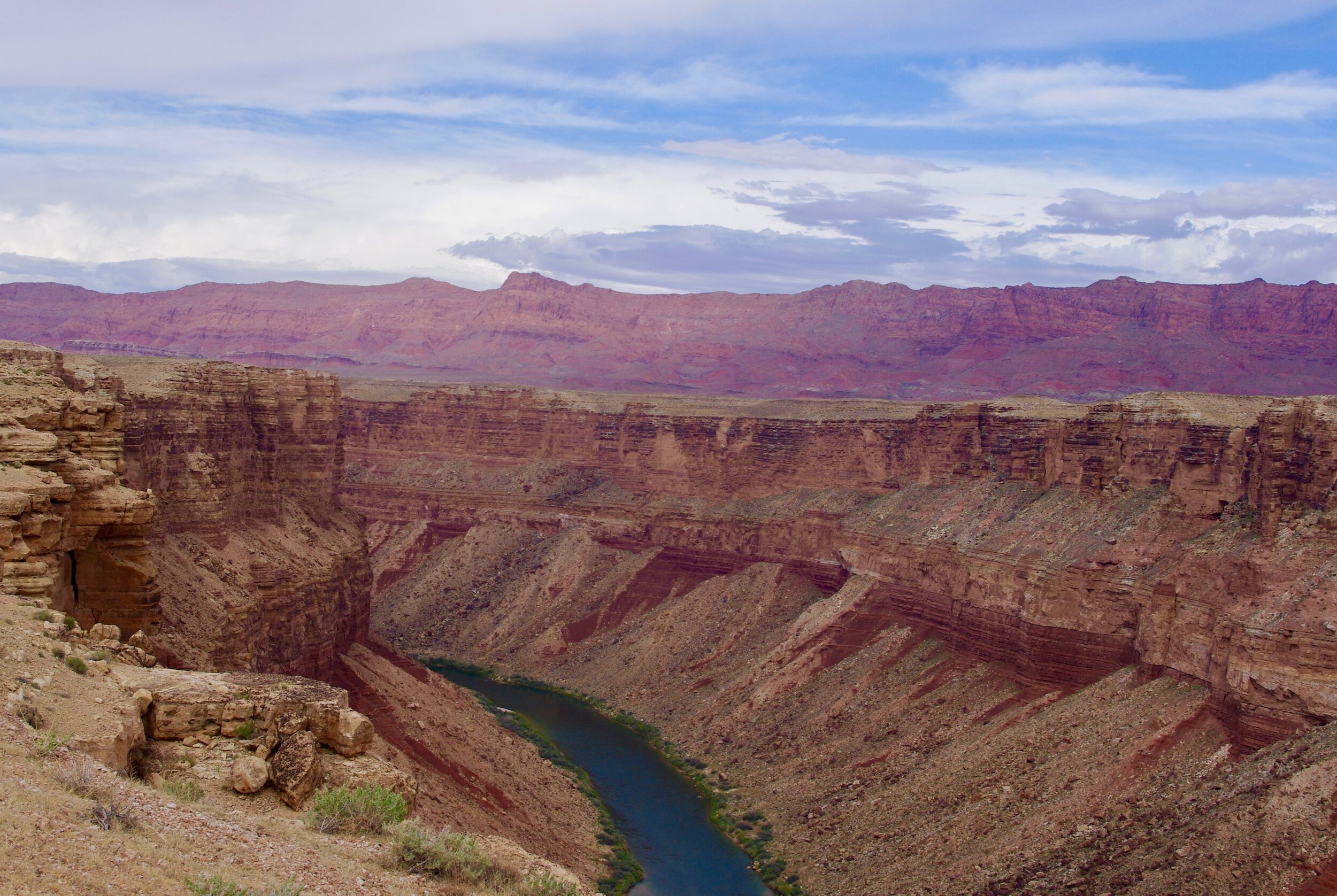 Here is the Colorado flowing through Marble Canyon with some more vermillion cliffs in the background. It looks more like a drainage ditch than the Mighty Colorado. Let us contrast this view with the below, which is the only glimpse of the Colorado that I could get from the top of the Grand Canyon…and believe you me, it was hard to find. I shot it with a 200 mm telephoto lens because otherwise it would have been invisible.