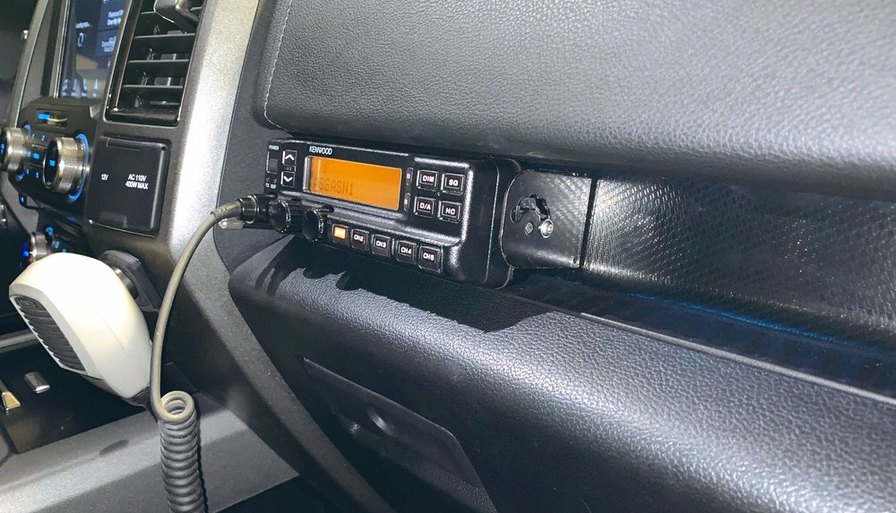 Kenwood head unit hard mounted into the cubby above the glove box on my 2018 Ford Raptor SuperCrew.