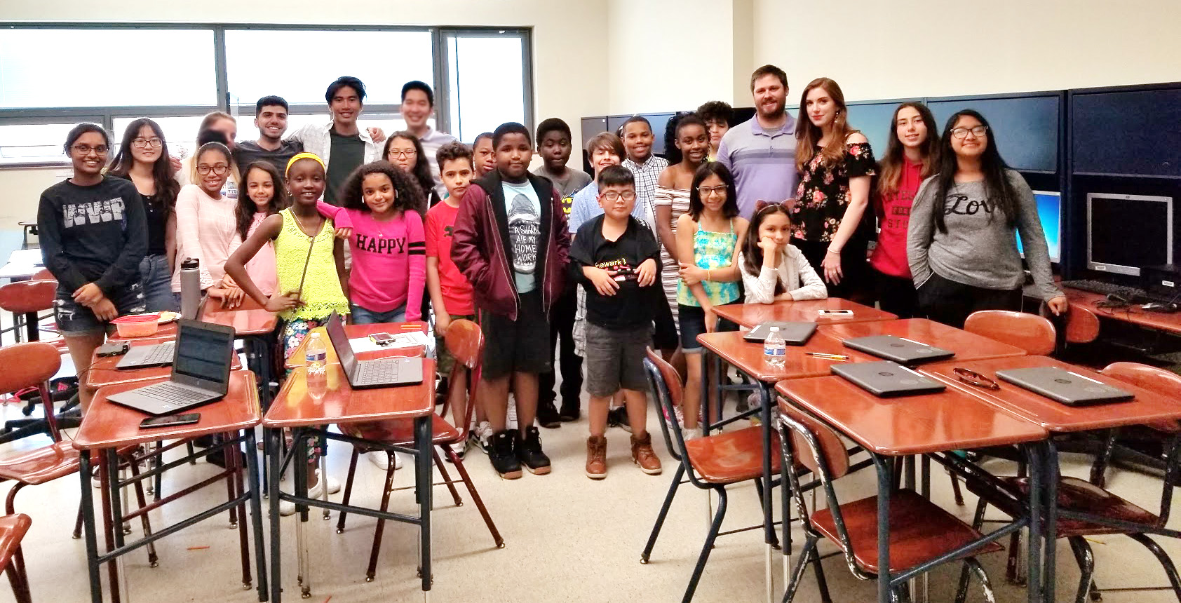 NJIT team members pose in a group shot with the wonderful user test participants from Science Park High School