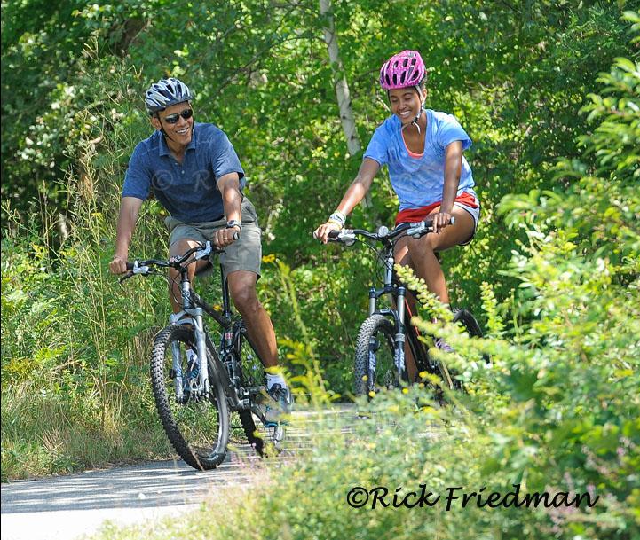 President Obama and daughter Malia bike riding on Martha's Vineyard