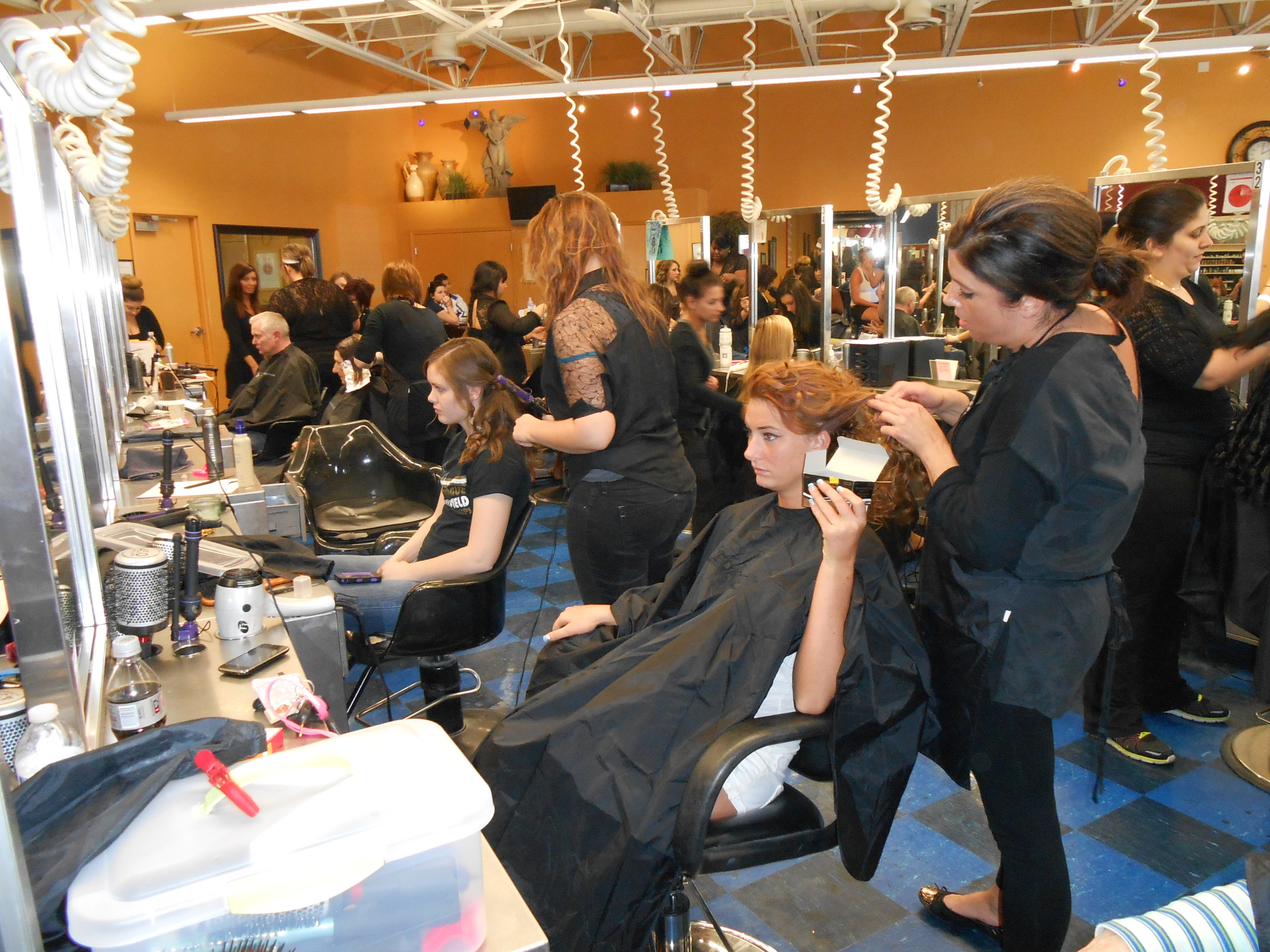 Students working on the clinic floor at Casal Aveda Institute