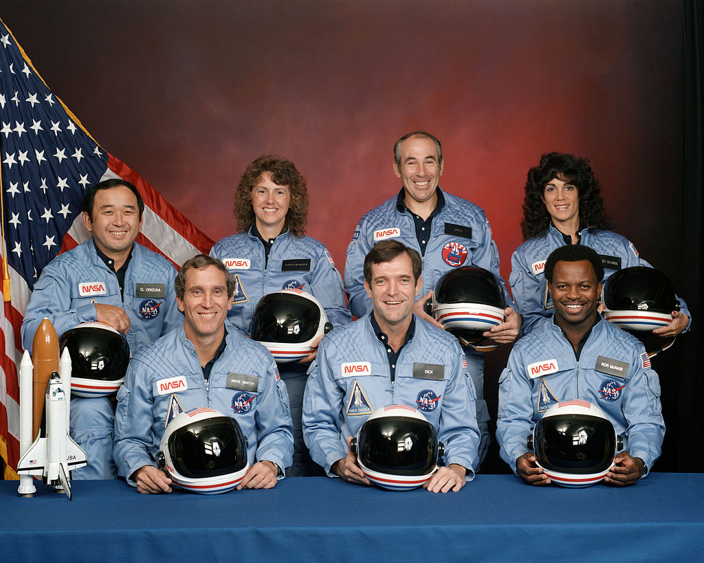 STS-51-L  crew: (front row)  Michael J. Smith  ,  Dick Scobee  ,  Ronald McNair  ; (back row)  Ellison Onizuka  ,  Christa McAuliffe  ,  Gregory Jarvis  ,  Judith Resnik  .