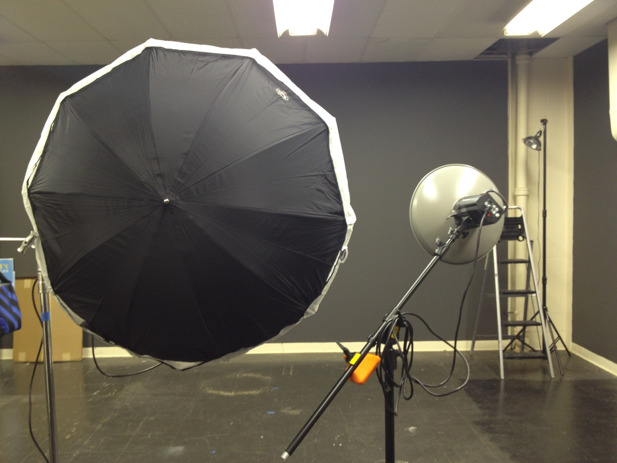 """The back of the Photek and the size compared to an Elinchrom 17"""" beauty dish reflector."""
