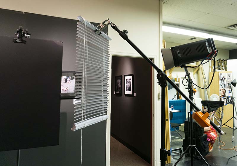 Foam core on a C-Stand, mini blind on a boom arm, and the Elinchrom RX1200