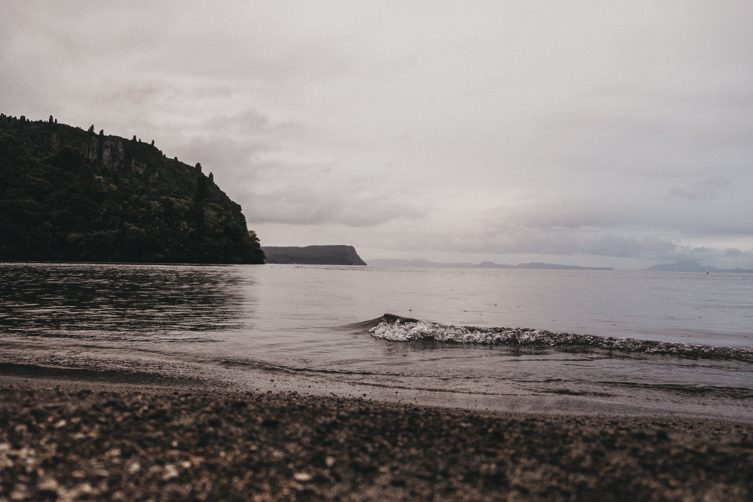 Day Three: small waves lapping on Lake Taupo's foreshore just before nightfall, photo by Nick (@nickforge)