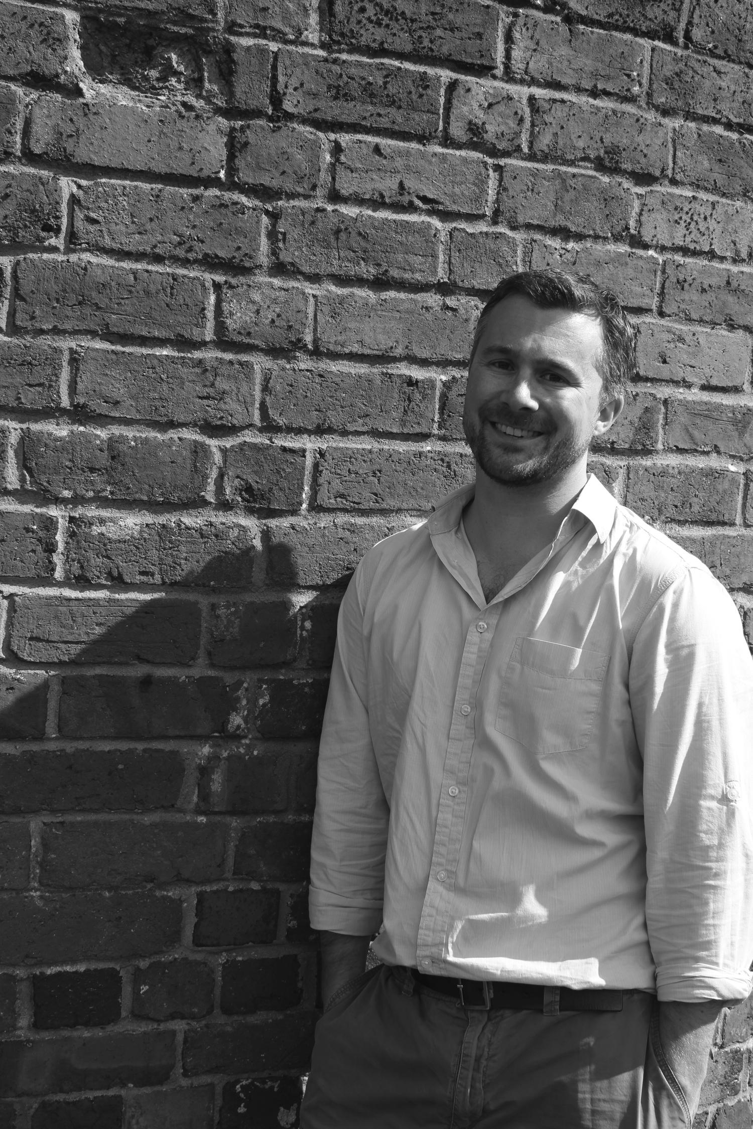 Birmingham architect Ben Mainwood with brick wall