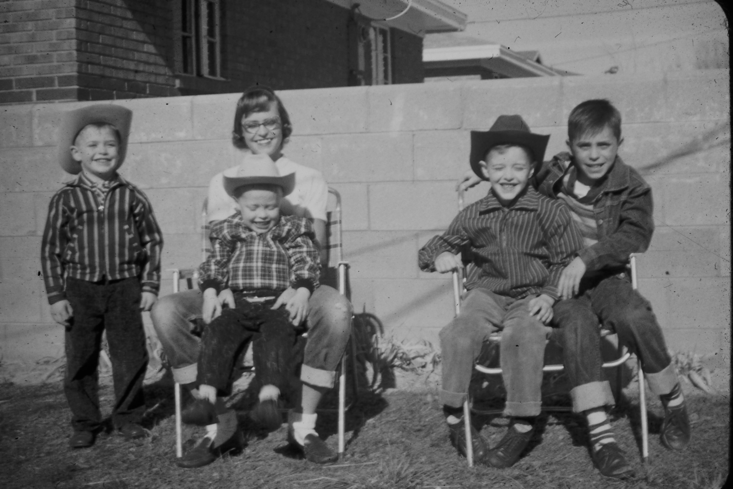 In our Aunt and Uncle's back yard in Albuquerque, with my brothers and I all decked out out in our western hats.