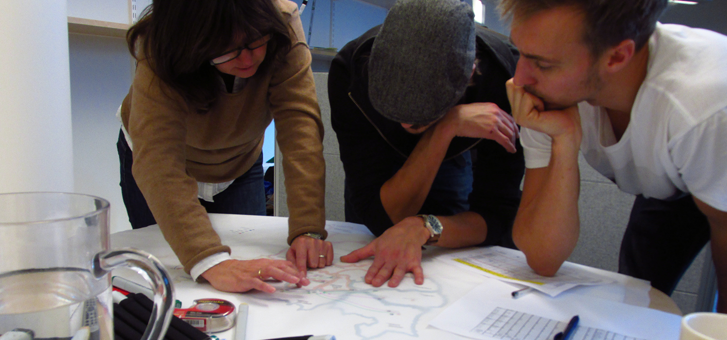 Our partner Bente reviewing the Oslo map with Simon and Rickard.