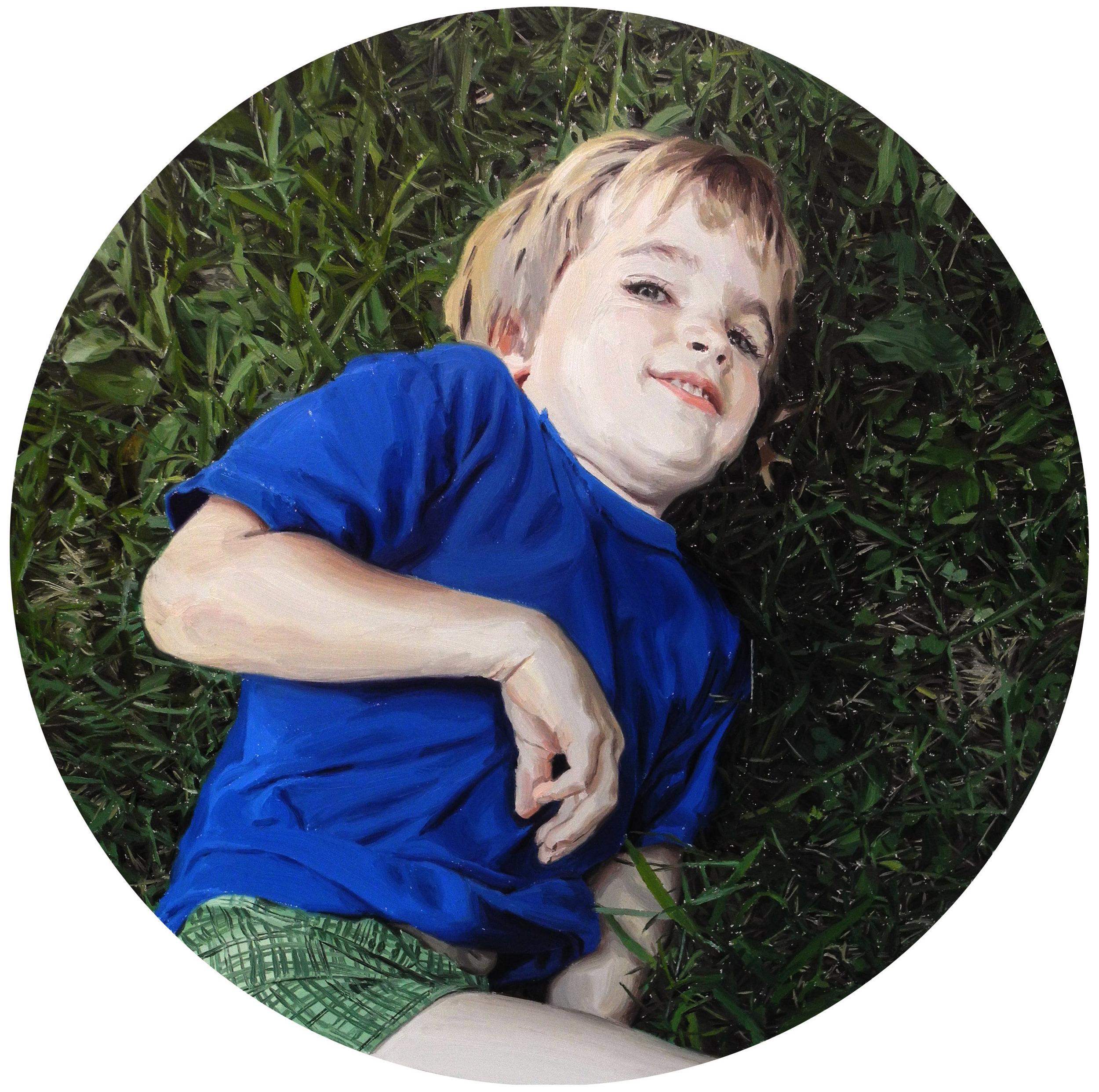 BOY LYING IN GRASS