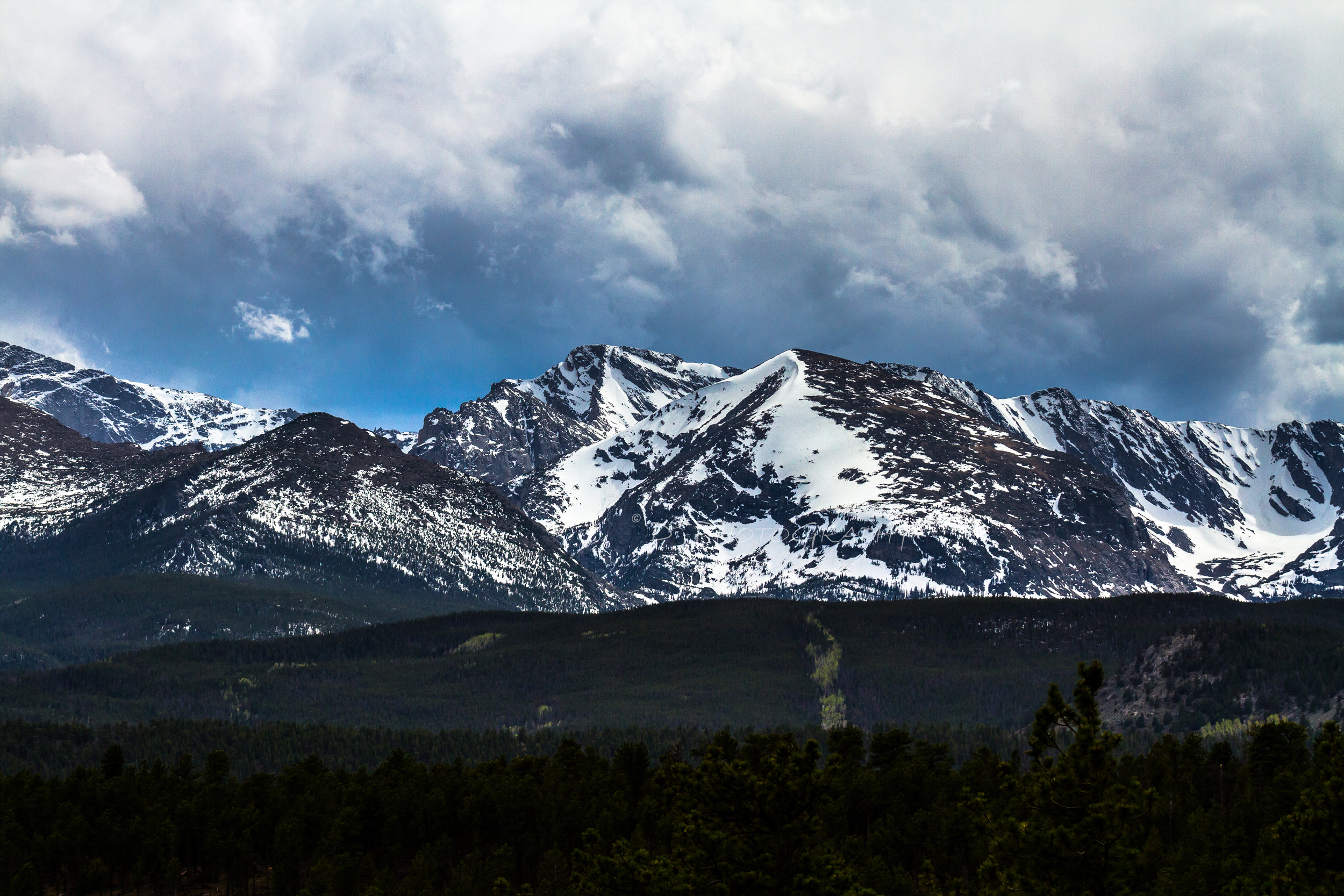 When this world stood still will you be there to feel the immense power? Rocky Mountain National Park, is a hue of violence always changing from the Earth's strong will to move forward