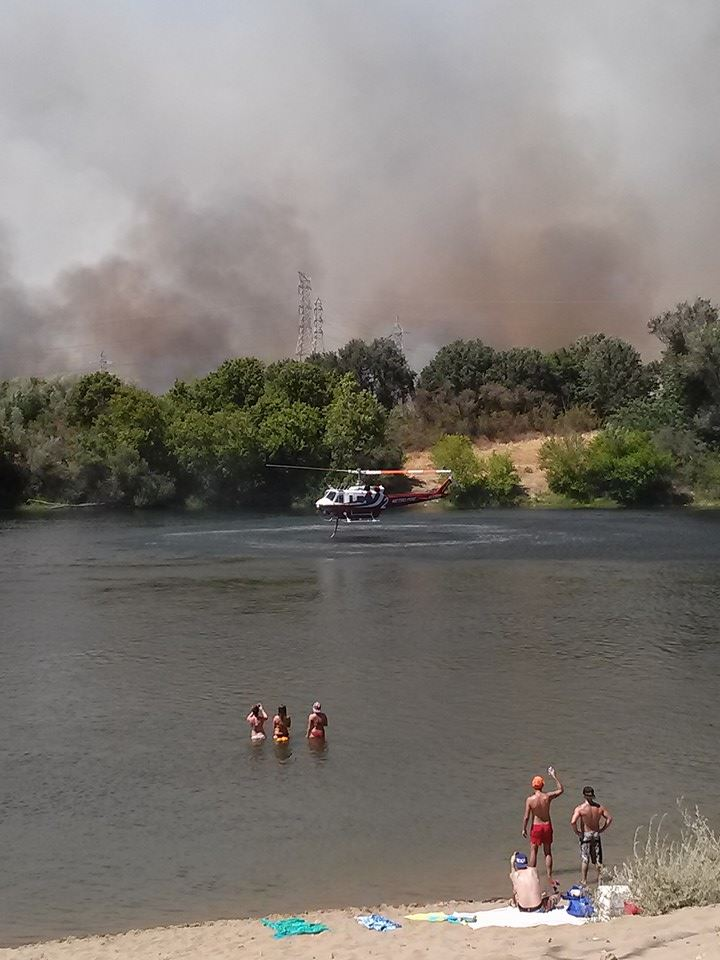 On the same day, I chased a fire by the American River on my bike and this is what I captured. Surreal and very sad.