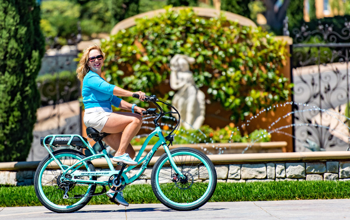 Teri Sawyer, one of   Pedego's   talented PR team members, shows off the joy of riding an electric bike. Image by   Allan Crawford  .